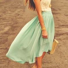 pastel spring dress..... I like the way it's a little shorter in the front and longer in the back! ;)