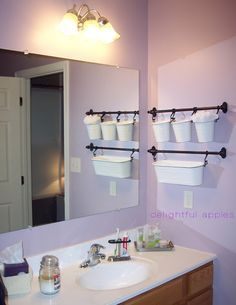 Bathroom storage - towel, hairbow, and more for little one. ikea baskets!- put this above the towel bar.