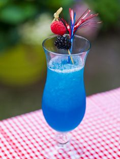 Frozen Blue Lemonade 1½ oz. white rum 1 oz. blue curacao 3 oz. Lemonade Sparkling ICE Garnish: blueberries  Combine all ingredients with ice in a blender. Blend on high until it becomes slushy. Pour into a glass and garnish with blueberries.