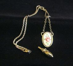 This is a wonderful vintage guilloche enamel and silver chatelaine perfume bottle on a sterling silver 20 inch chain. The sterling silver chain measures approximately 20 inches, and the drop with the