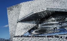 On a Tuesday afternoon in January, the winter sun glinted off the Philharmonie de Paris as if it had been specially summoned to show off the distinct patterning of cast aluminium and reflective steel. Arrayed in an MC Escher-esque motif, the 340,000 ti...