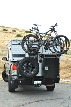 Aluminess swing away bike rack swing arm on a Toyota Tundra with Aluminess Rear Bumper 4x4 Camper Van, Camper Parts, Popup Camper, Camper Life, Slide In Truck Campers, Truck Camping, Truck Bed Tent, Hitch Bike Rack, Sprinter Rv