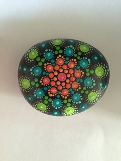 A personal favorite from my Etsy shop https://www.etsy.com/listing/464132566/mandala-stone-hand-painted-rock-dot