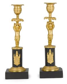 A pair of Empire style gilt and patinated bronze figural candlesticks fourth quarter 19th century