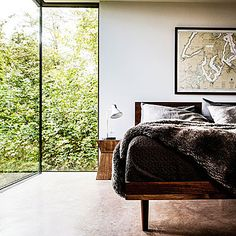 Balance cool with warm - Get a Mid-Century Modern Look - Sunset Balance cool with warm To keep a mid-century modern–style space from looking cold, layer on some textured accents. The simple addition of a faux-fur throw and a textured bedspread make this minimalist bedroom instantly inviting.
