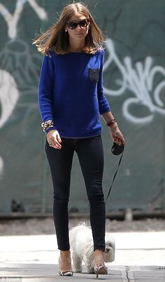 She's not ruff: Olivia Palermo looked stylish as she took her dog a walk in New York today
