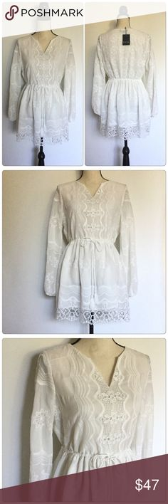 Gorgeous White Dress V-Neck Very gorgeous white dress V-Neck, 100%Polyester and lining 100%Polyester. The style is perfect for any seasonal have a tie around your waist cute floral pattern. FATE Dresses Mini