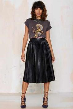 I love to pair a rock n roll t-shirt or element with a more romantic and feminine piece like a pleated midi skirt.