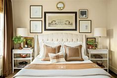 In this master bedroom, the homeowner was going for a gentleman-architect vibe with wool blackout curtains, cream walls, a tufted headboard, and a collection of sketches that he did while traveling through Italy.    See more of this classic Birmingham home.