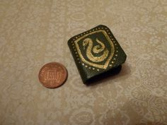 Nov Slytherin Harry Potter Hogwarts House miniature book, probably to turn into a necklace, though it's a bit big. By QueenHare for the Design Every Day Project Slytherin Harry Potter, Hogwarts Houses, My Design, Miniatures, Big, Projects, Log Projects, Blue Prints, Minis