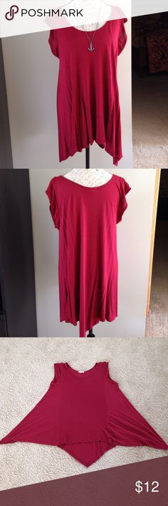 Flowy Wine Colored Top Long and flowing asymmetric cut top in a gorgeous red wine color.  In excellent condition except for a tiny hole I found near the hemline.  100% rayon, hand wash. Paper + Tee Tops Tunics