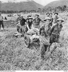 "Cheerful Australian ""diggers"" carrying supplies, Kokoda area, November These supplies had been air dropped by Dakota (Douglas cargo) planes of the US Army Air Force coming from Port Moresby over the precipitous mountains in background. Anzac Memorial, Douglas Dc3, Army Pics, Anzac Day, British Soldier, Fallen Heroes, Remembrance Day, Lest We Forget, Papua New Guinea"