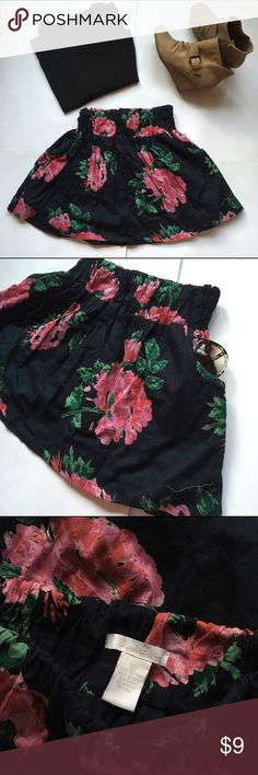 Cute Mini Floral Skirt Super adorable two layered black mini skirt with a floral design from Charlotte Russe | Lightweight and chiffon like | Has two pockets at the side | The elastic band on top is somewhat tight, I'd say it runs like an XXsmall | Excellent condition Charlotte Russe Skirts Mini