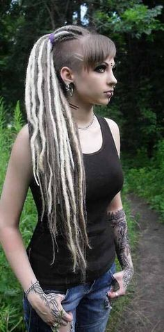 Dreads Love her razored side swept bangs and the shaved design next to them