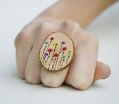 cocktail ring made from a painted tree branch slice (mine would have a gnome on it - OF COURSE)