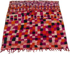 This is a stunningly beautiful and rare 1970s saddle rug (most likely for a donkey or mule) from the Boujad region of Morocco. The creative pattern and design is reminiscent of a Paul Klee painting, featuring colour blocks of deep cerise pink, pale pinks, ivory, black and orange in a random checkerboard pattern with squares of random sizes. Unusually, the rug is square in shape. With fringing to one end, this is a beautiful piece, a rare find.