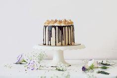 Chocolate cake, fluff filling, chocolate/fluff filling frosting, ganache, graham cracker/marshmallow decorations.