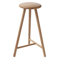 The Perch bar stool from Nikari features a simple, clean-lined design that pays respect to Japanese aesthetics. Crafted from oak, the round seat stands on three slender legs, united by a convenient foot bar.