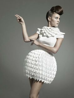Designers: Mercedes Arocena & Lucia Benitez, Model: Steffi Rauhut Their collection uses the aspects of origami such as folding, creasing and building of the structures out of rectangles and patterns without the use of paper.