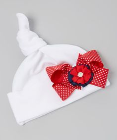This White & Red Polka Dot Bow Single-Knot Beanie by tiny bundles is perfect! #zulilyfinds...Too Cute!