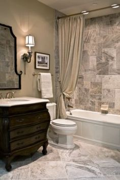 beautiful neutrals; like all tile--pattern in shower and floor (large tile & the pattern in which they are laid)