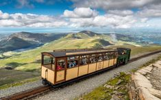 """Mountain Train, by AdrianEvans """" The Snowdon Mountain Railway is a narrow gauge rack and pinion mountain railway in Gwynedd, north-west Wales. It is a tourist railway that travels for miles from Llanberis to the summit of Snowdon, the highest. Landscape Photos, Landscape Photography, Travel Photography, Underground Trampoline, History Of Wales, Snowdonia National Park, Visit Wales, Train Rides, Wonderful Places"""