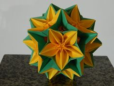Designers: Carmen Sprung ( Carambola), David Mitchell (Electra) Folder: Michal Pikula Paper: copy Unit: pentagon, square 42 units: 12 pentagons, 30 squares Assembled with glue Folded in October2012