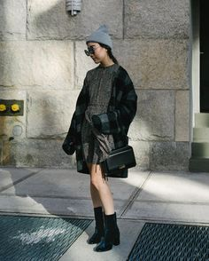 31 Perfect Looks To Copy This December #refinery29  http://www.refinery29.com/2016/12/131522/new-outfit-ideas-december-2016#slide-4  For days that aren't quite so cold, balance out a mini skirt with a pair of boots and a beanie.Apiece Apart dress, Isabel Marant jacket, Dear Frances shoes, Want Les Essentiels bag, Stella McCartney hat....