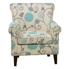Upholstered club chair with a floral motif.   Product: Club chairConstruction Material: Hardwood and fabric