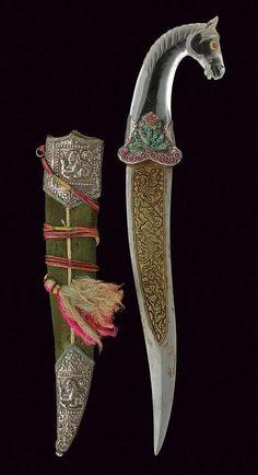 Khanjar Dagger. Dated: circa 1900. Culture: Indian. Medium: steel, gold, rock crystal, silver, wood, velvet, emerald, coral, garnet. | Copyright © 2015 Czerny's International Auction House S.R.L.