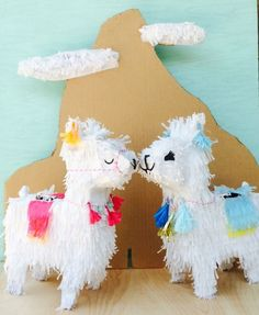 Como se llama? This darling llama piñata would be great for your next boho themed party! Adorned with tassels and pom poms just like those fancy llamas in Peru! Details: Piñata is 24 tall x 14 wide x 7 deep. Features hand fringed paper and festive...