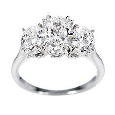 HarryWinston Oval-Shaped Diamond and Platinum Engagement Ring