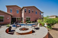 Amazing backyard INCLUDES AN ELEGANT VENETIAN GLASS POOL, WATERFALLS, TUMBLED PAVERS, CANTERRA STONE, FIRE PIT, OUTDOOR KITCHEN, BUILT-IN SEATING, WALL FOUNTAIN, DECKS, PATIOS & COURTYARD