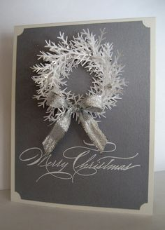 handmade Christmas card ... white wreath made up of punched foliage ... mat silver/gray background ... silver ribbon bow ... lots of depth so will need a box or hand delivery ...