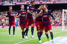 (L-R) Gerard Pique, Sergio Busquets, Dani Alves and Luis Suarez celebrate with their teammate Lionel Messi after scoring the opening goal during the La Liga match between FC Barcelona and RCD Espanyol at Camp Nou on May 8, 2016 in Barcelona
