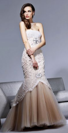 I'm not a huge fan of the dress but the lighting and the way the model is posed is something I'd like to recreate.  Couture Charm  Pearled Strapless Mermaid Style Evening Gown by Sherri Hill