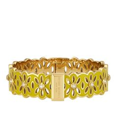 <p>The Medium Cutout Bangle is a must-have for spring. Crafted with beautifully plated brass and adorned with Swarovski crystals, this designer bracelet simply blooms.</p>