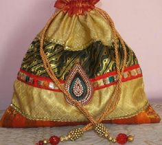 Handmade drawstring tricolour brocade batua/potli bag by Dream Catchers Studio Kolkata. Contact-8017943060.