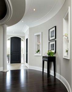 Brown floor grey wall white trim and black door