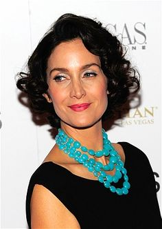 With The Great Gatsby on the big screen, it's natural that Jazz Age hairstyles are making a comeback. Carrie-Anne Moss' haircut keeps the shape and the curls, without a flapper haircut's rigorous — and hard to maintain — structure.