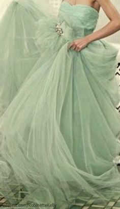 Yards and yards of celadon green fabric make up this luscious Cinderella-like gown.