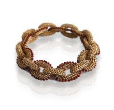 Golden bracelet by Tove Rygg