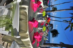 Sage Satin Linen w/ hot pink.  Bride made the Paper flowers for centerpieces.