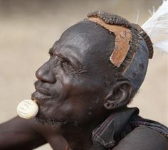 Africa | Turkana elders of Turkana, Kenya wear decorative ivory lip ornaments, secured in position by a spigot which is inserted in a hole pierced below the man's lower lip after initiation. This singular form of decoration was once widespread but is rarely seen today. | © Nigel Pavitt