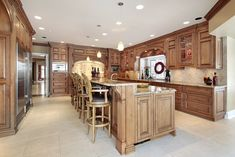 All wood kitchen with large 2-tiered kitchen island with custom stools