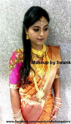 Traditional Southern Indian bride, Karuna wears bridal silk saree and jewellery for her Reception. Makeup and hairstyle by Swank Studio. #BridalSareeBlouse #SariBlouseDesign #GoldJewellery #BridalHair #DarkLips #jhumkis #jhumkas #SilkSari   Tamil bride. Telugu bride. Kannada bride. Hindu bride. Malayalee bride.   Find us at https://www.facebook.com/SwankStudioBangalore