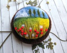 Needle felted brooch with blue poppies. Original gift for mom, sister or girlfriend.   Felt brooch 100% natural and eco friendly. Brooch is fitted with a metal brooch pin. 6 cm in diameter  Brooch packed in gift box  Please note that the color actually brooch may look a little different from the colors in the pictures on your screen.  More needle felted brooches you can see here https://www.etsy.com/ru/shop/FeltAccessories?ref=hdr_shop_menu