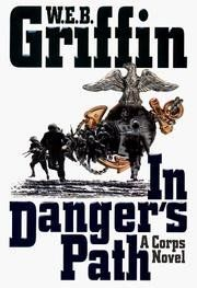 In Dangers Path a Corps Novel by W. E. B. Griffin http://www.amazon.com/dp/B001BY07H0/ref=cm_sw_r_pi_dp_m-I7tb0W83QR1