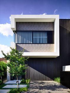 This modern duplex conceals the garages and utility room behind black stained vertical timber cladding Duplex House Design, Loft Design, Modern House Design, Townhouse Designs, Architecture Design, Australian Architecture, Modern Garage, Modern Exterior, Exterior Design