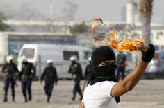 An anti-government protester throws a molotov cocktail at riot-police during  clashes  in the village of Salmabad, Bahrain. Credit: Zeep van der Kist via Flickr